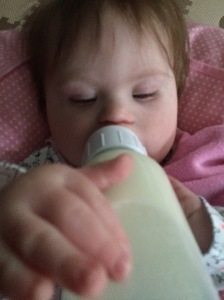 Post surgery Hannah loves her bottles!